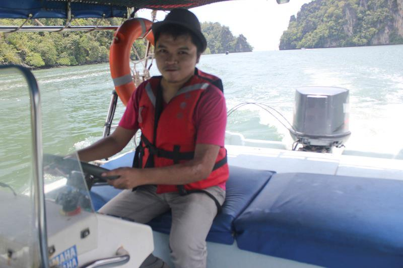 Driving a speedboat for the first time. Sorry, blurred. Blame Kuya driver.